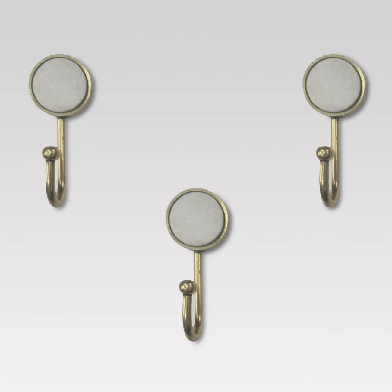 Three gold metal hooks