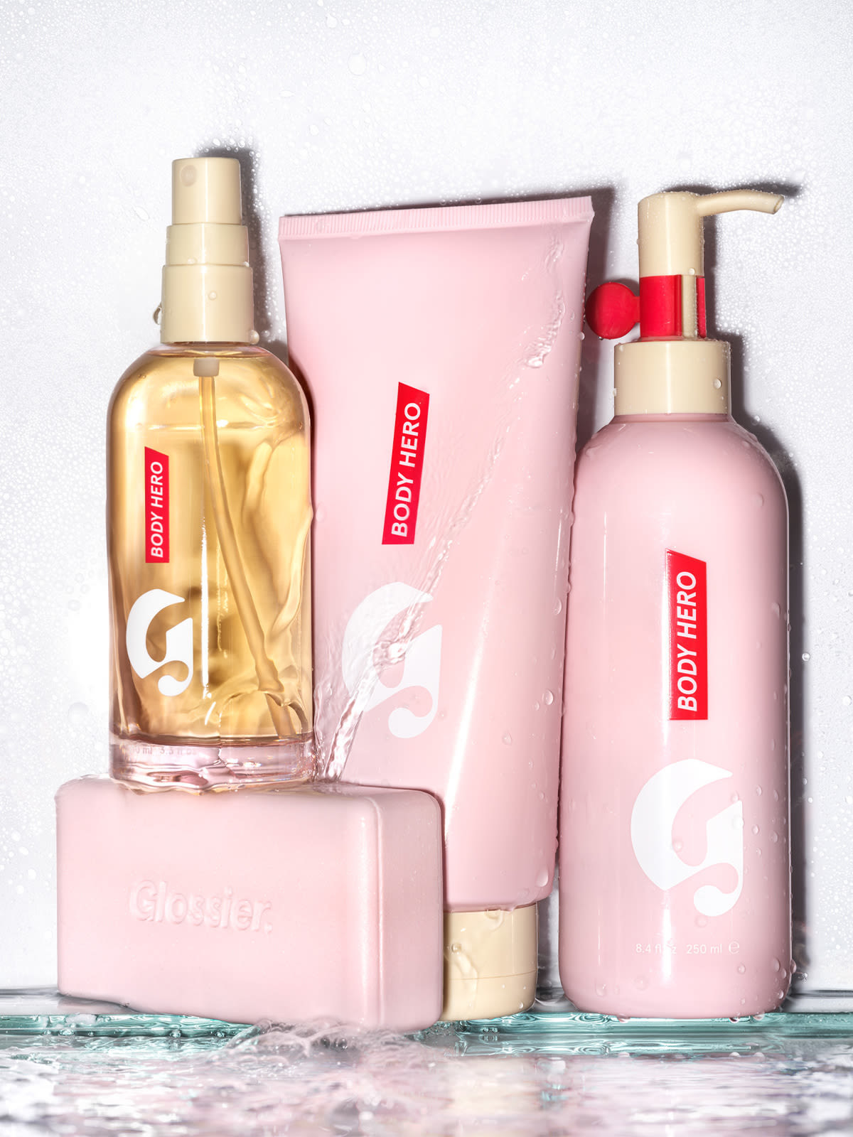 All four of the body products that are included in the set in their pink packaging