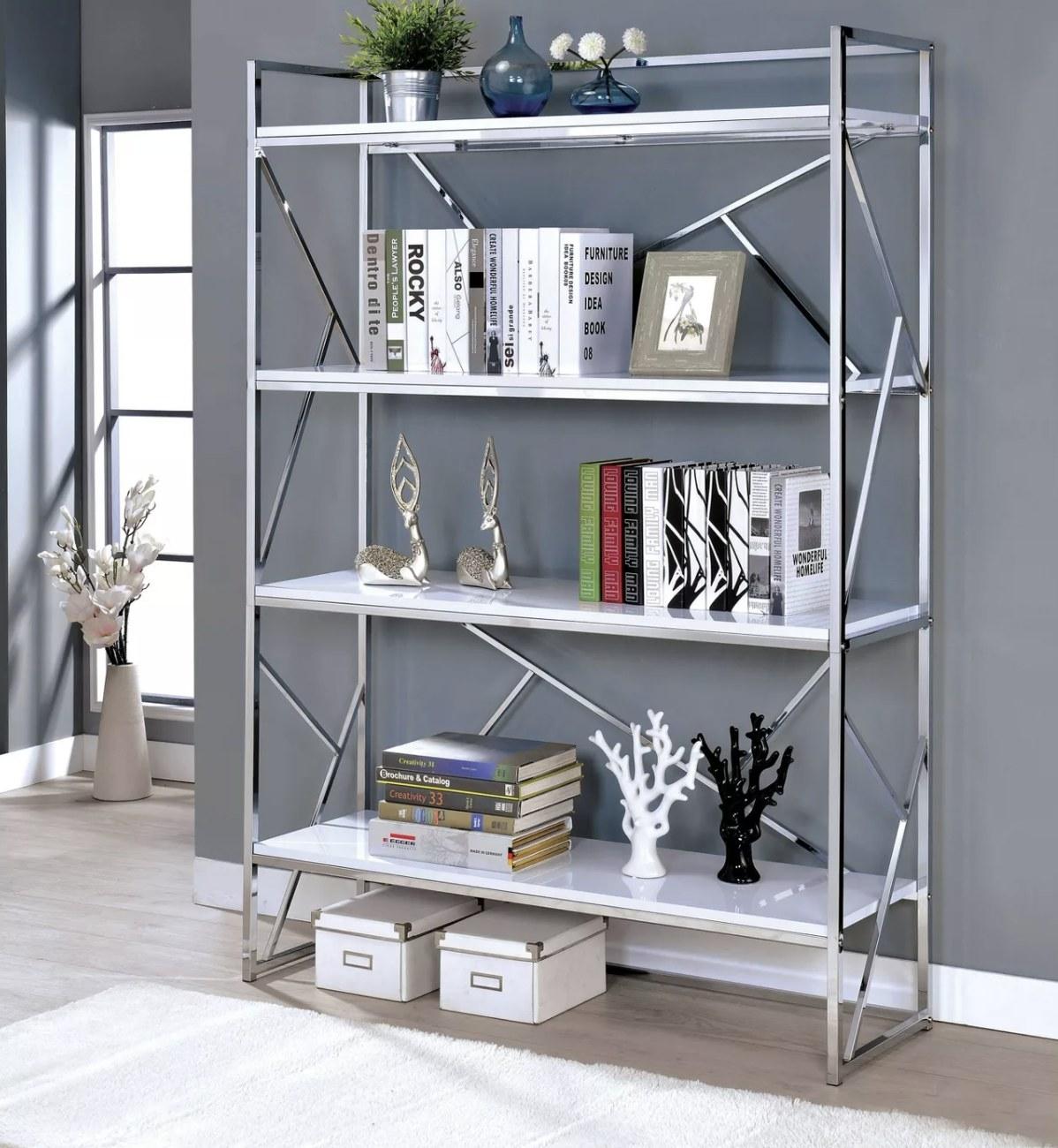 A silver chrome and white open bookcase