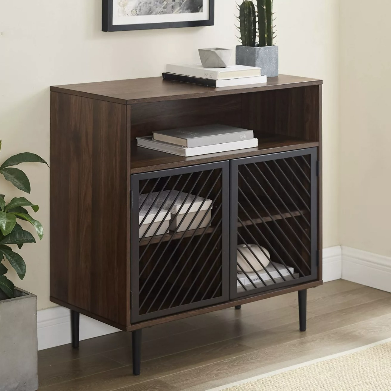 A dark walnut accent cabinet with see-through doors