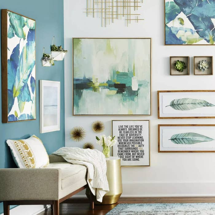 Three sea urchin wall decor on a gallery wall in a living space