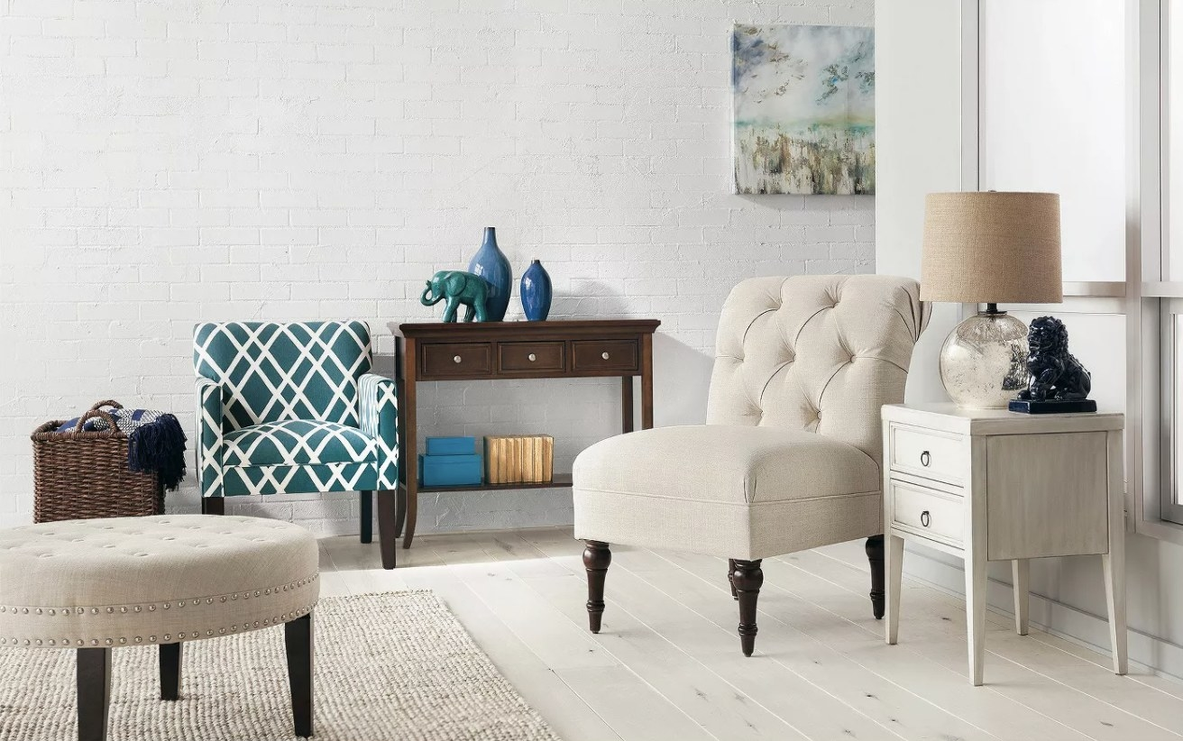 A cream upholstered accent chair