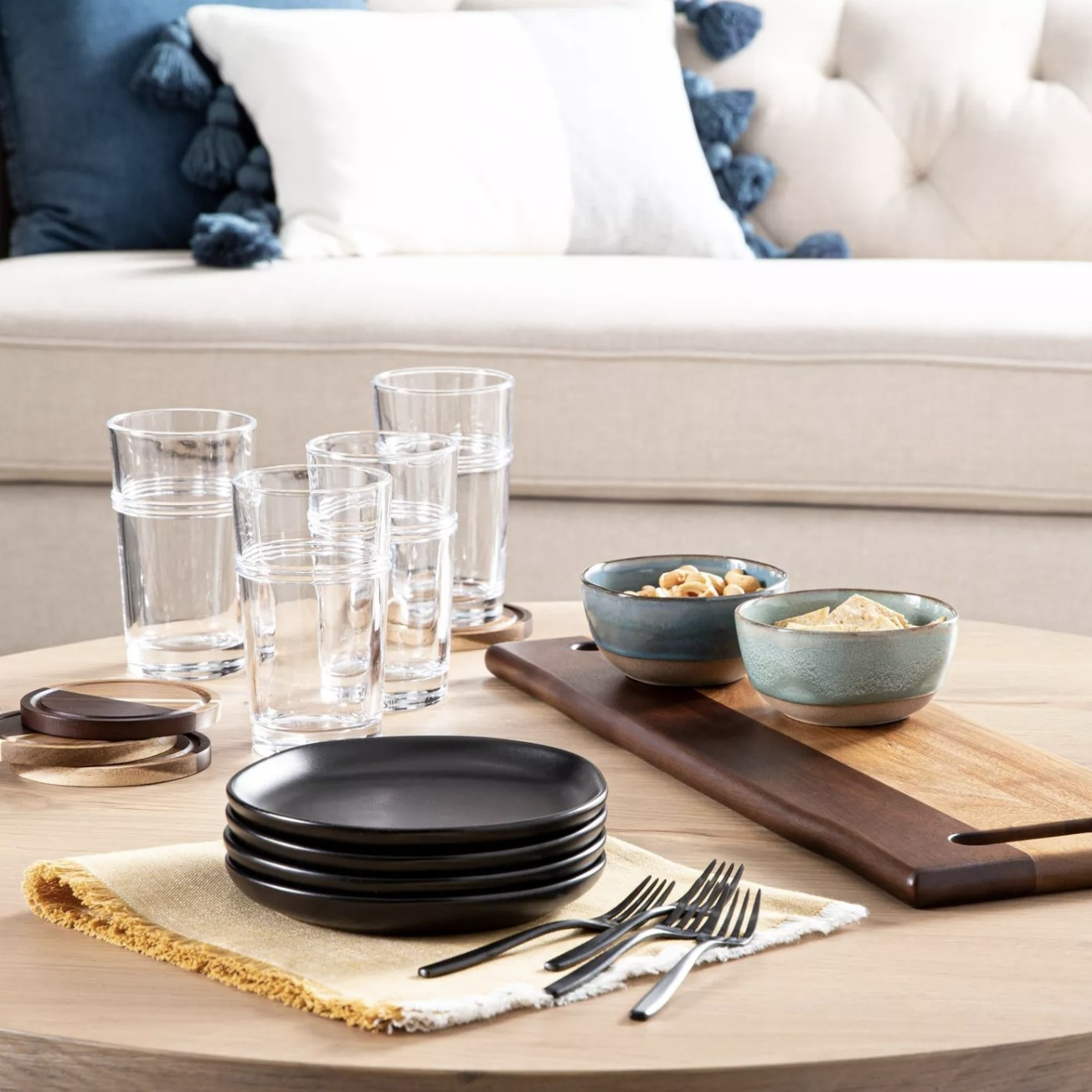The wood coasters on a coffee table