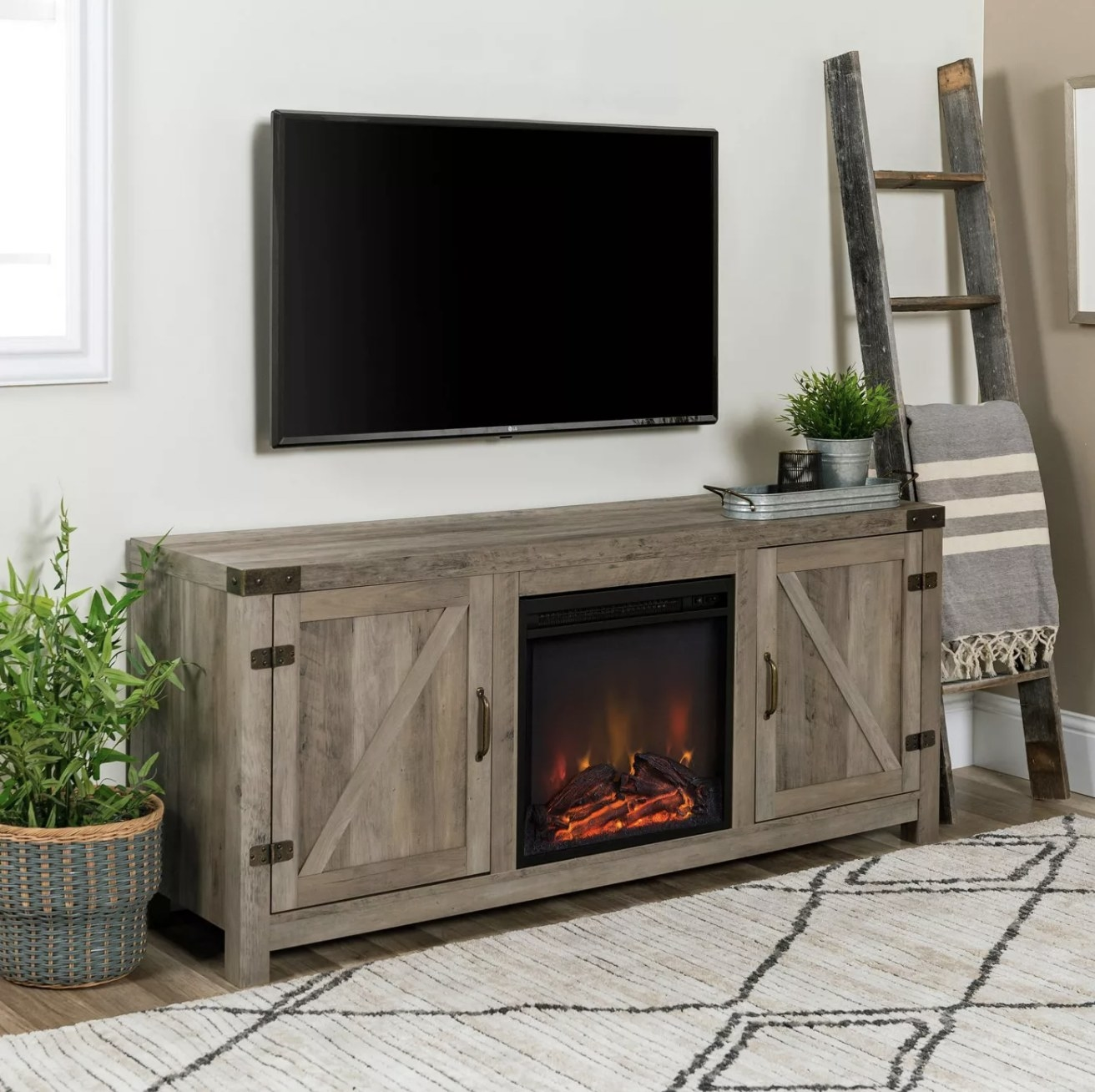 The weathered wood fireplace TV stand under a mounted TV