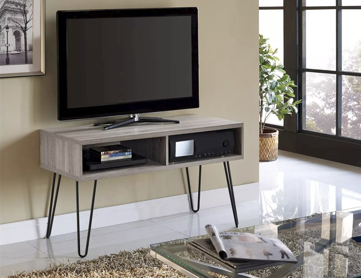 The retro-style tv stand in gray with black hairpin legs