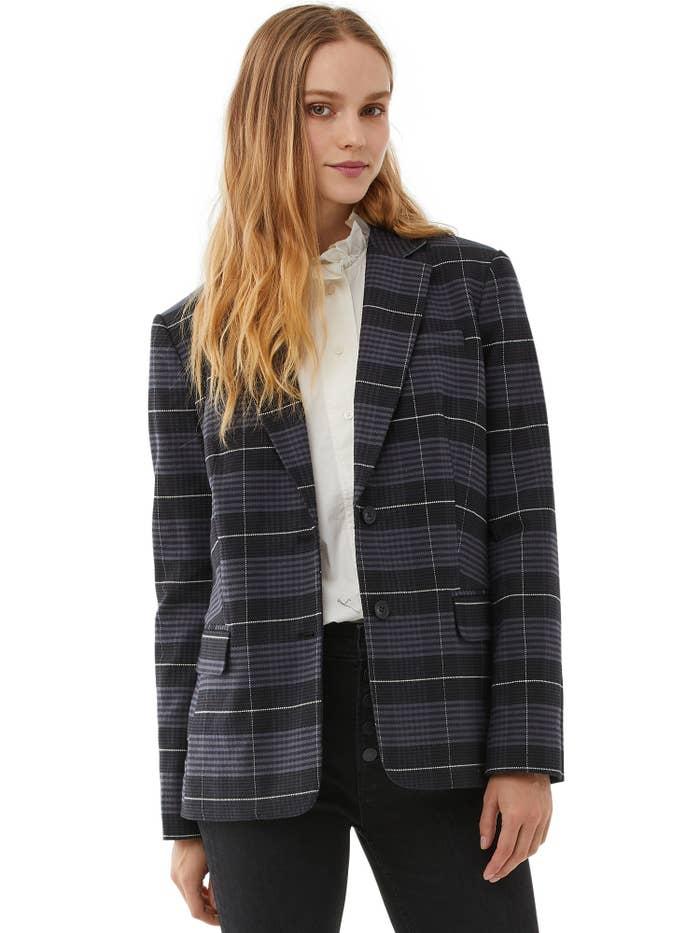 model wearing plaid grey blazer