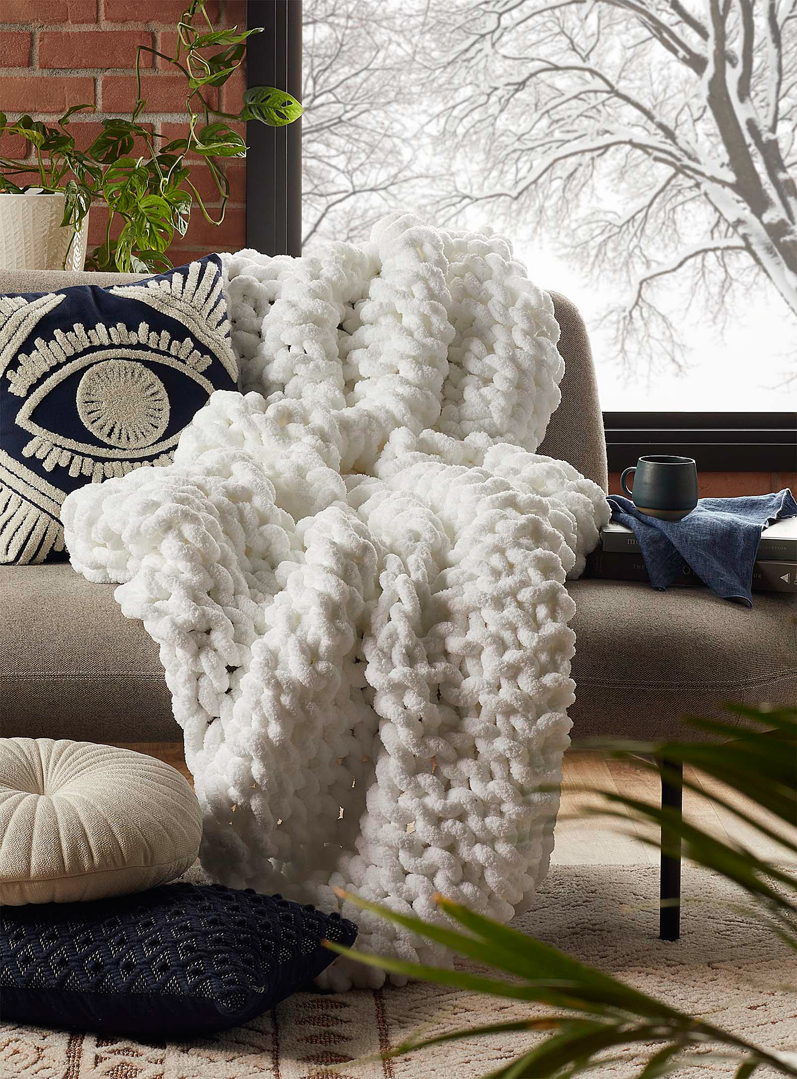 A chunky knit blanket on a chair