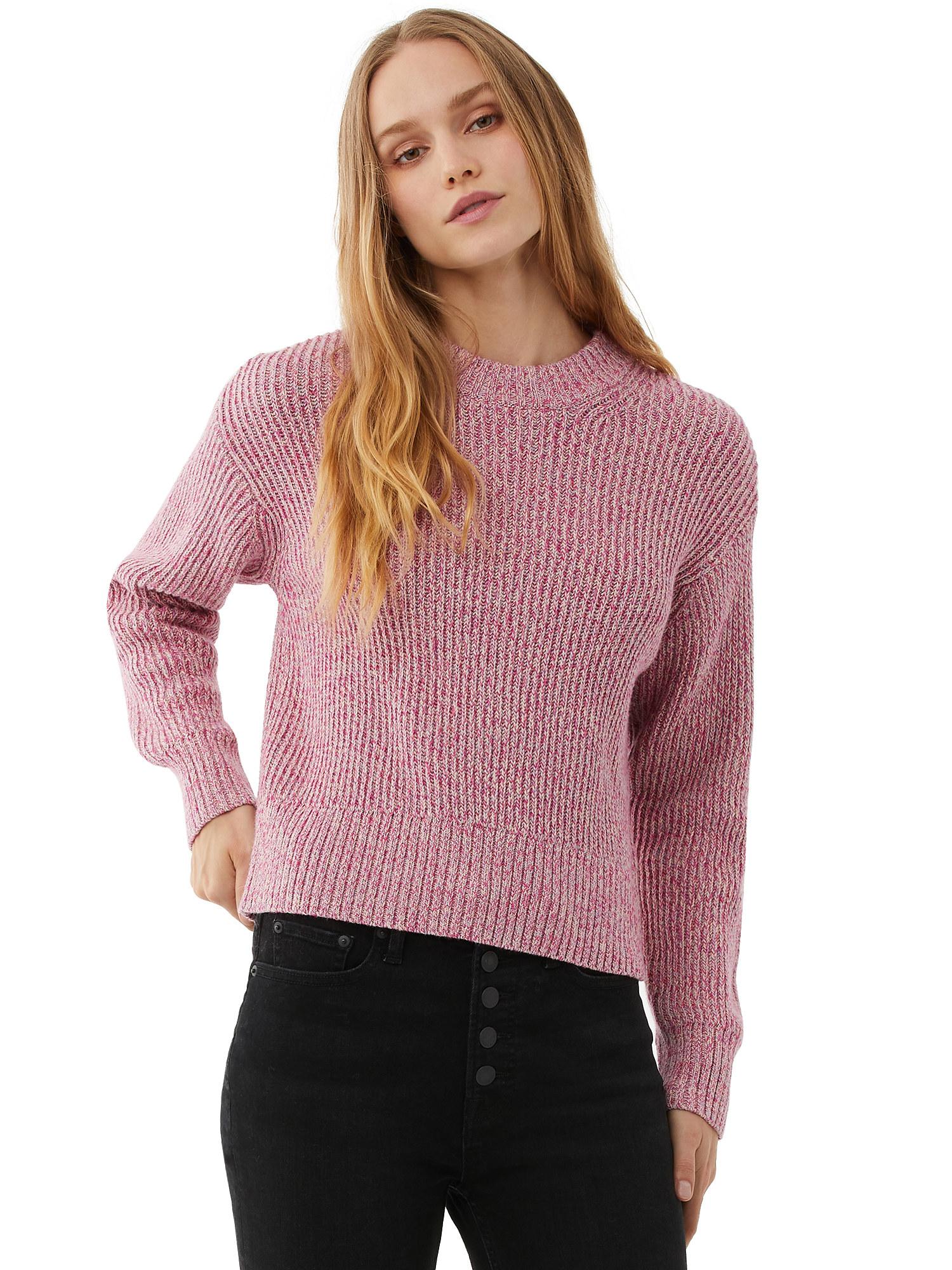 Model wearing pink crewneck sweater