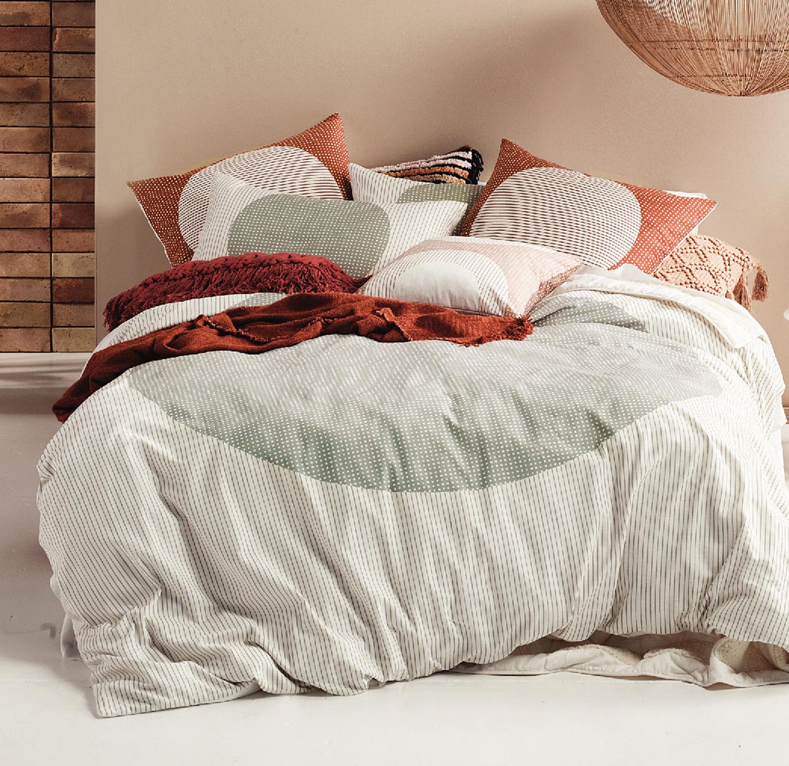 A duvet on a bed covered with pillows
