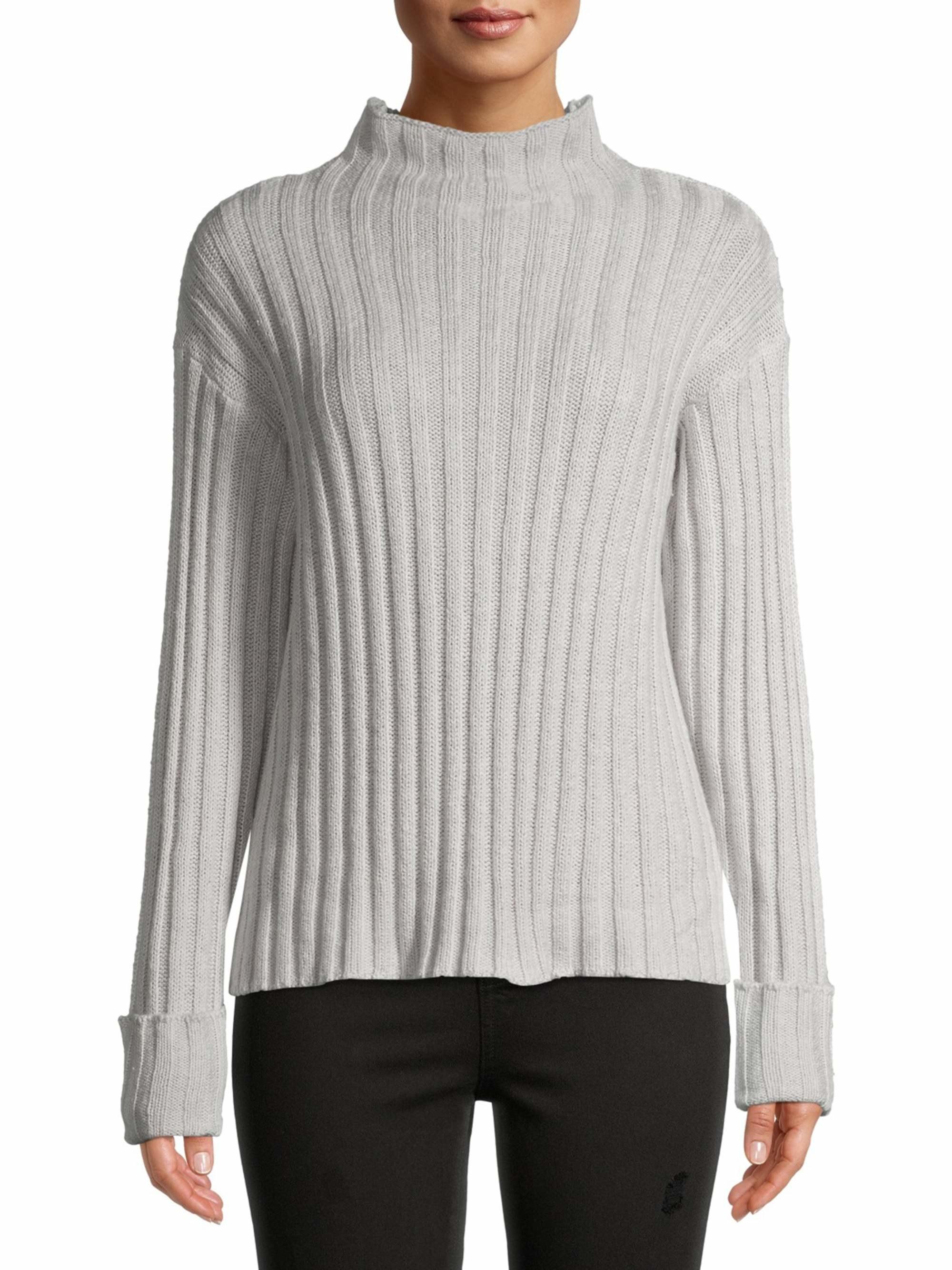 Model wearing a grey mock-neck sweater