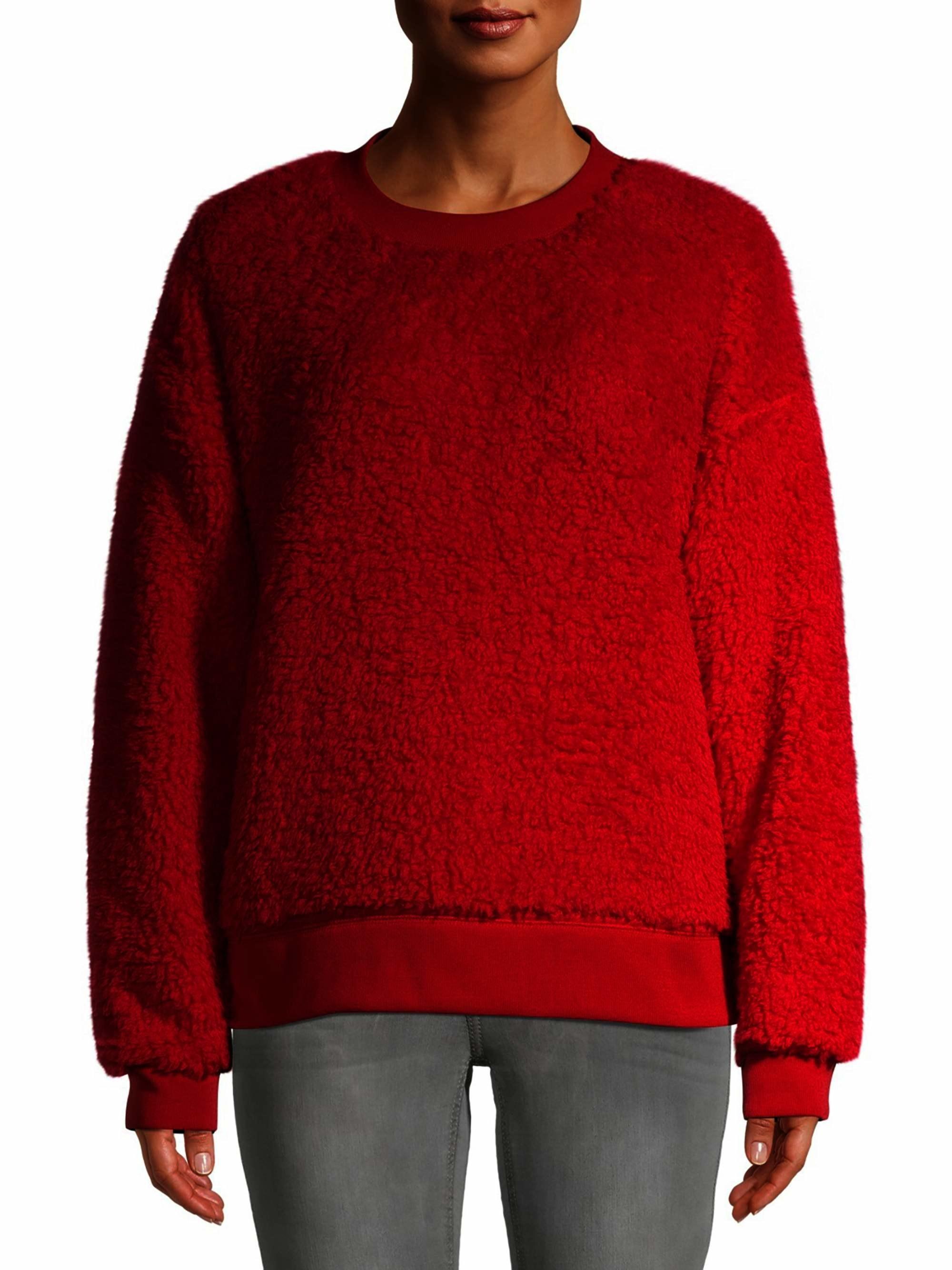 Model wearing fuzzy red sweater