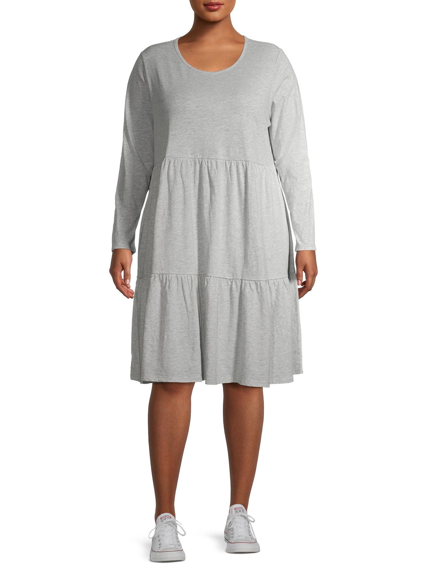 Model wearing grey tiered dress