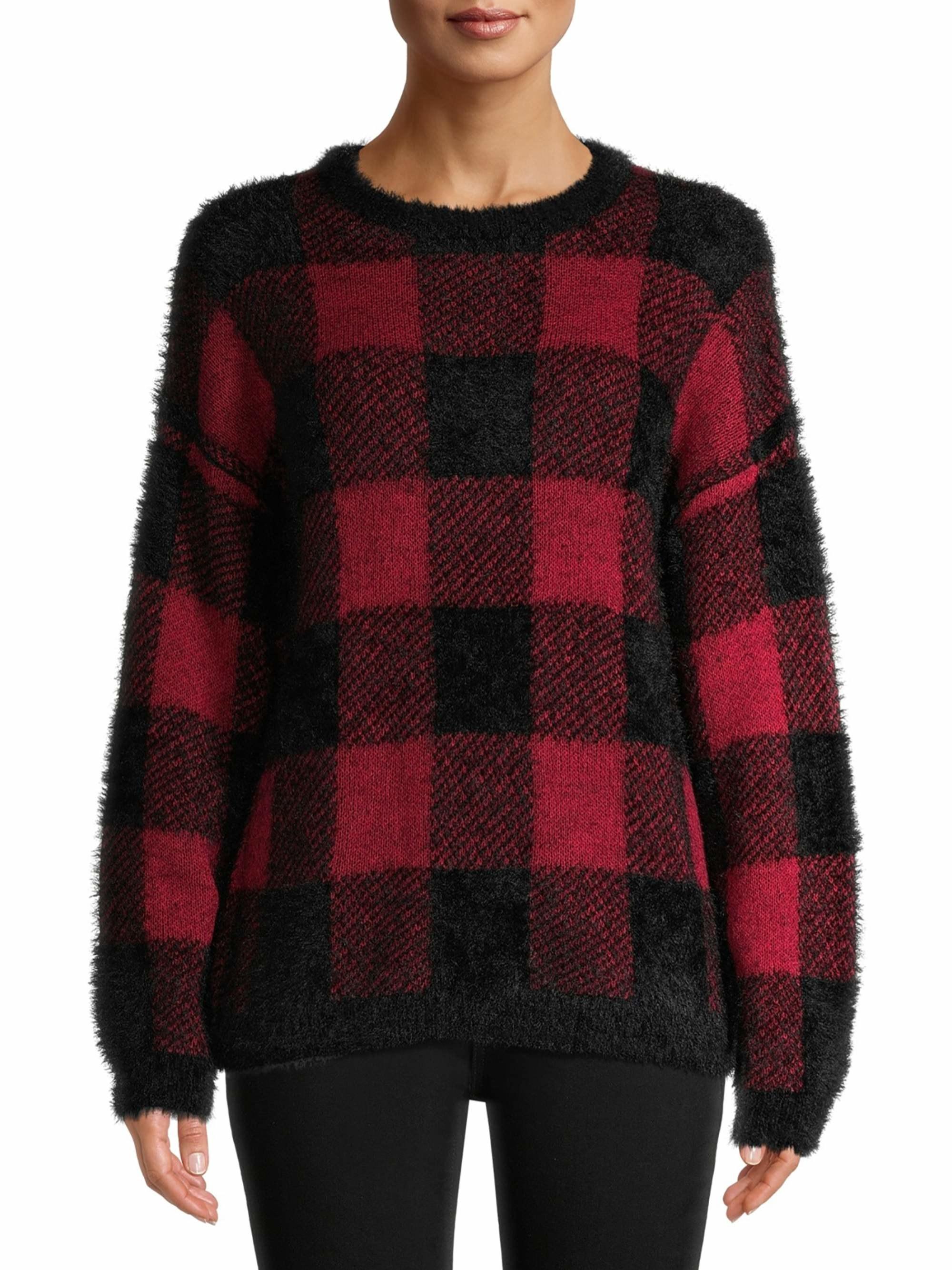 Model wearing buffalo plaid sweater
