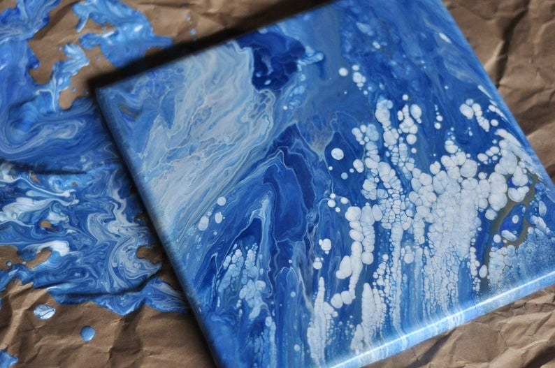 Blue and white drip painting on square canvas