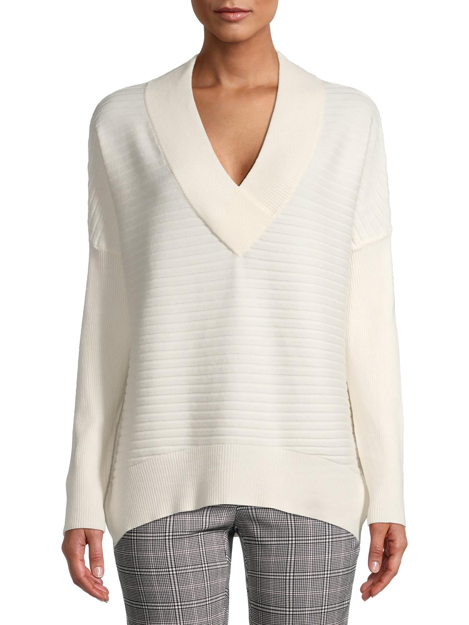 Model wearing cream v-neck pullover