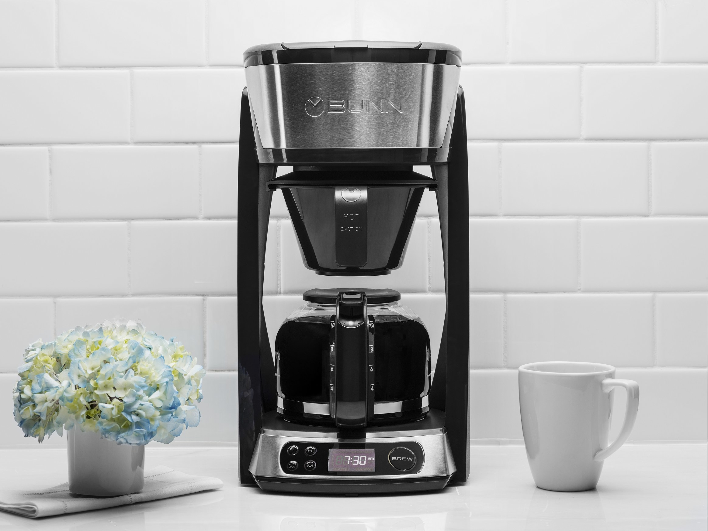 stainless steel and black coffee maker on a kitchen counter