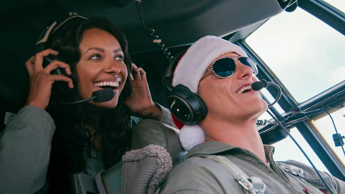 Andrew Jantz and Erica Miller flying in an army plane.