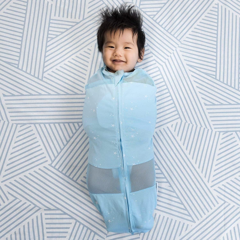 Child model in light blue sleep sack