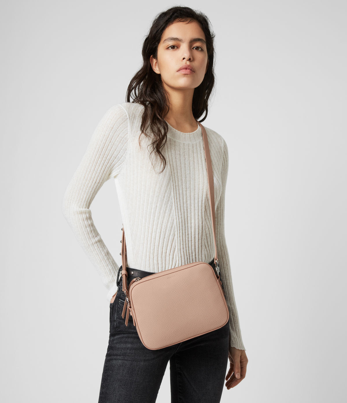 model wearing light pink rectangle shape crossbody bag