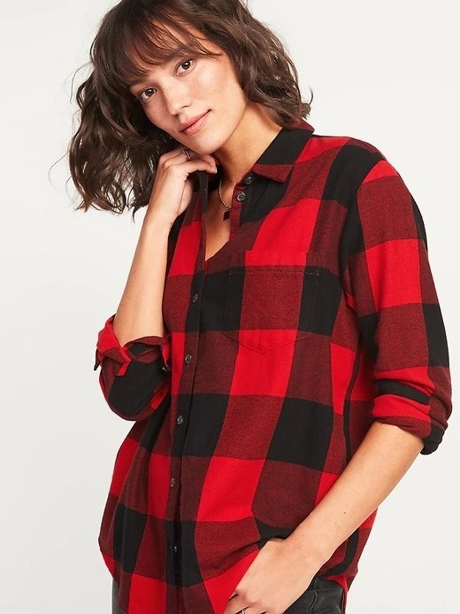A woman wearing a large black and red flannel