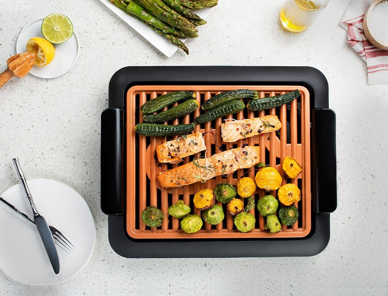 salmon and vegetables cooking on a electric smokeless grill
