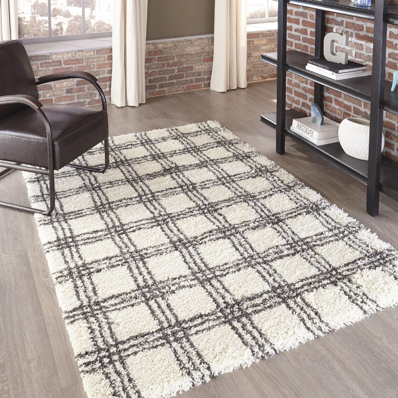 Medium-sized white and black patterned area rug