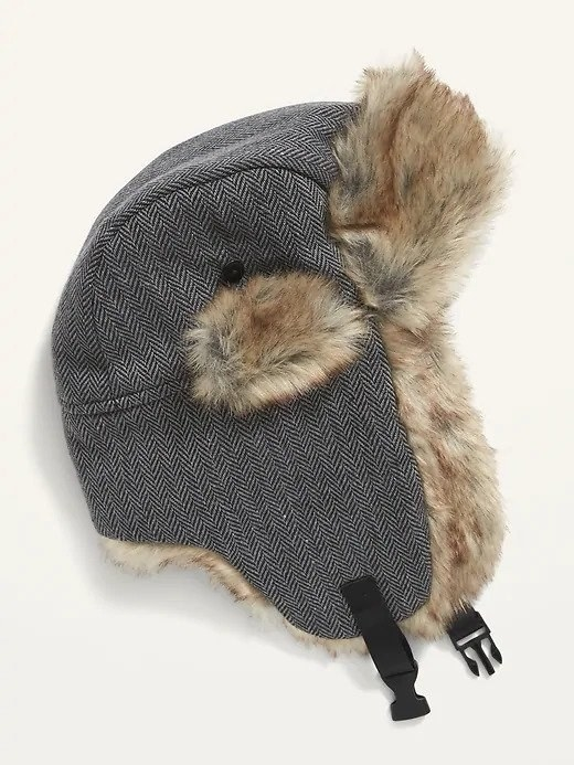 A grey trapper hat with light brown faux-fur on the inside