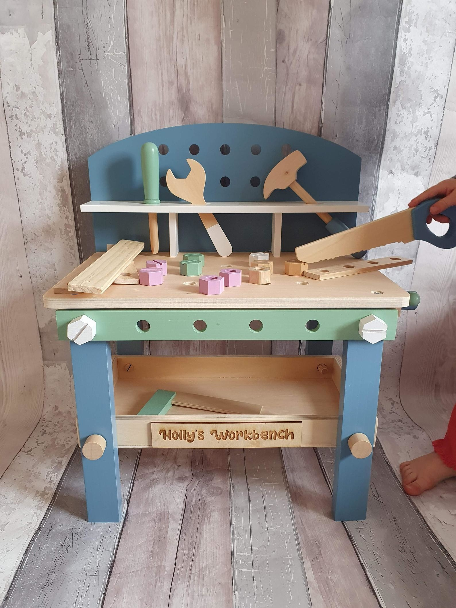Multi-colored wooden toy workbench