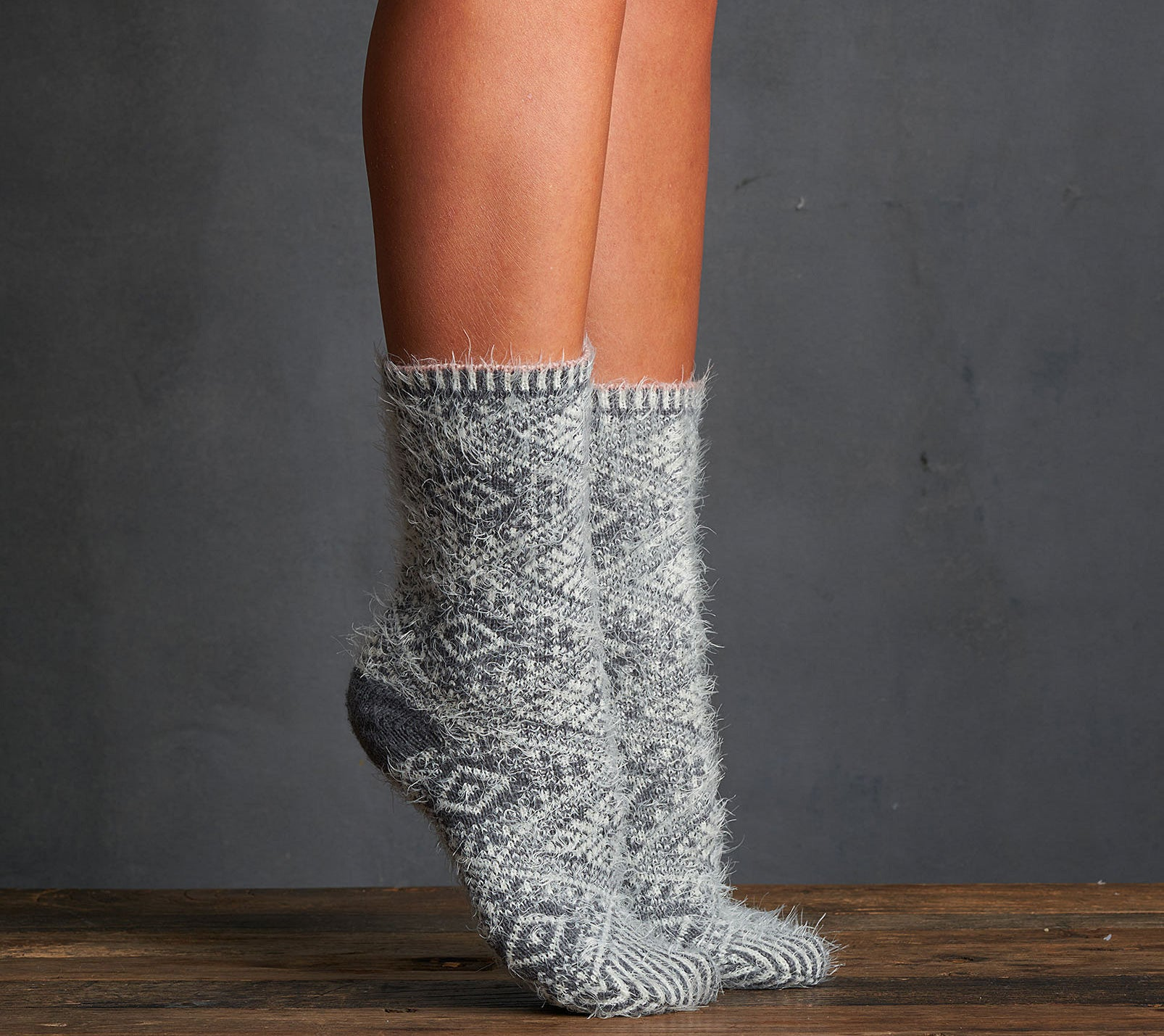 A person wearing fluffy socks