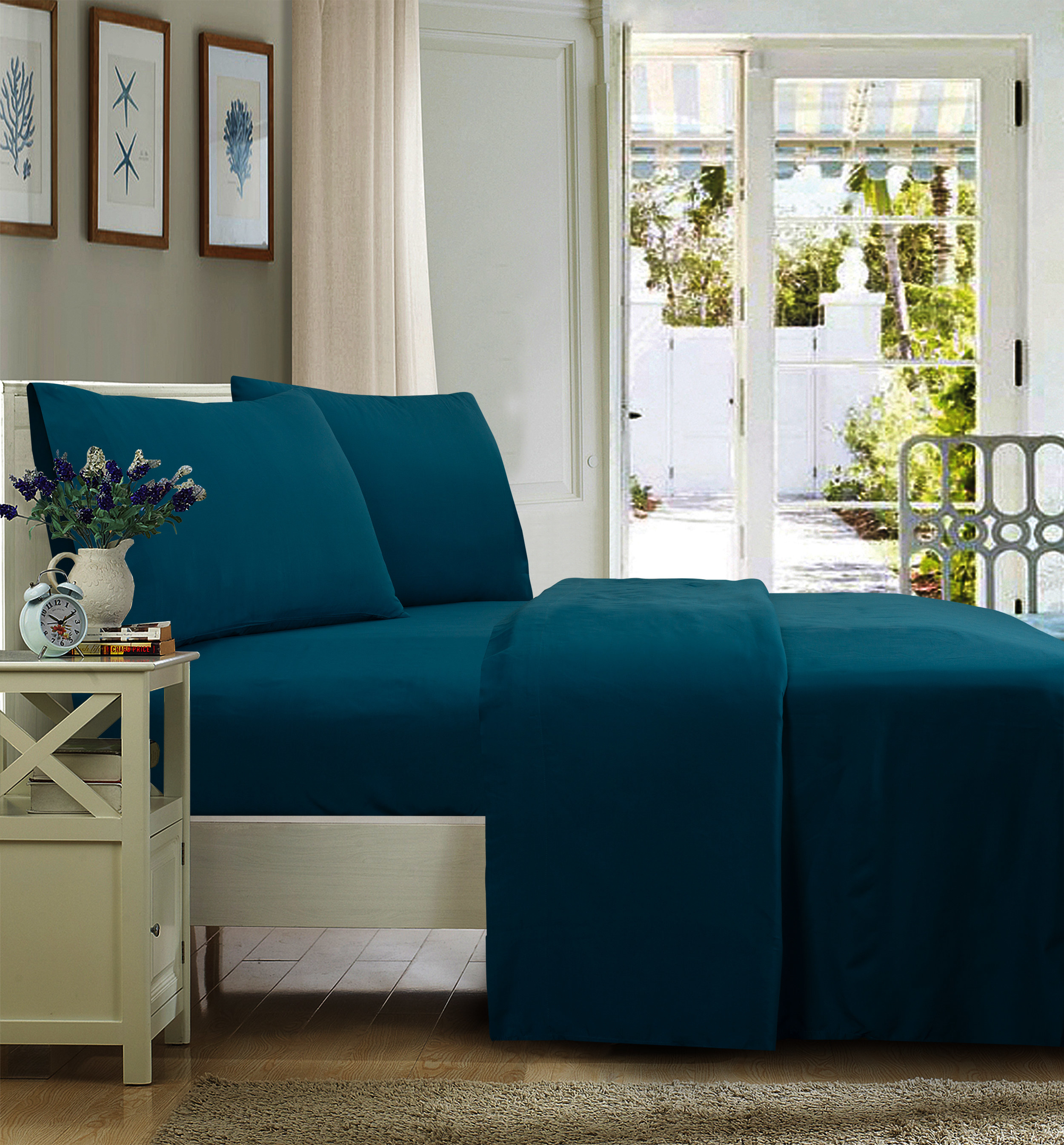 The wrinkle-resistant sheets in dark teal on a bed
