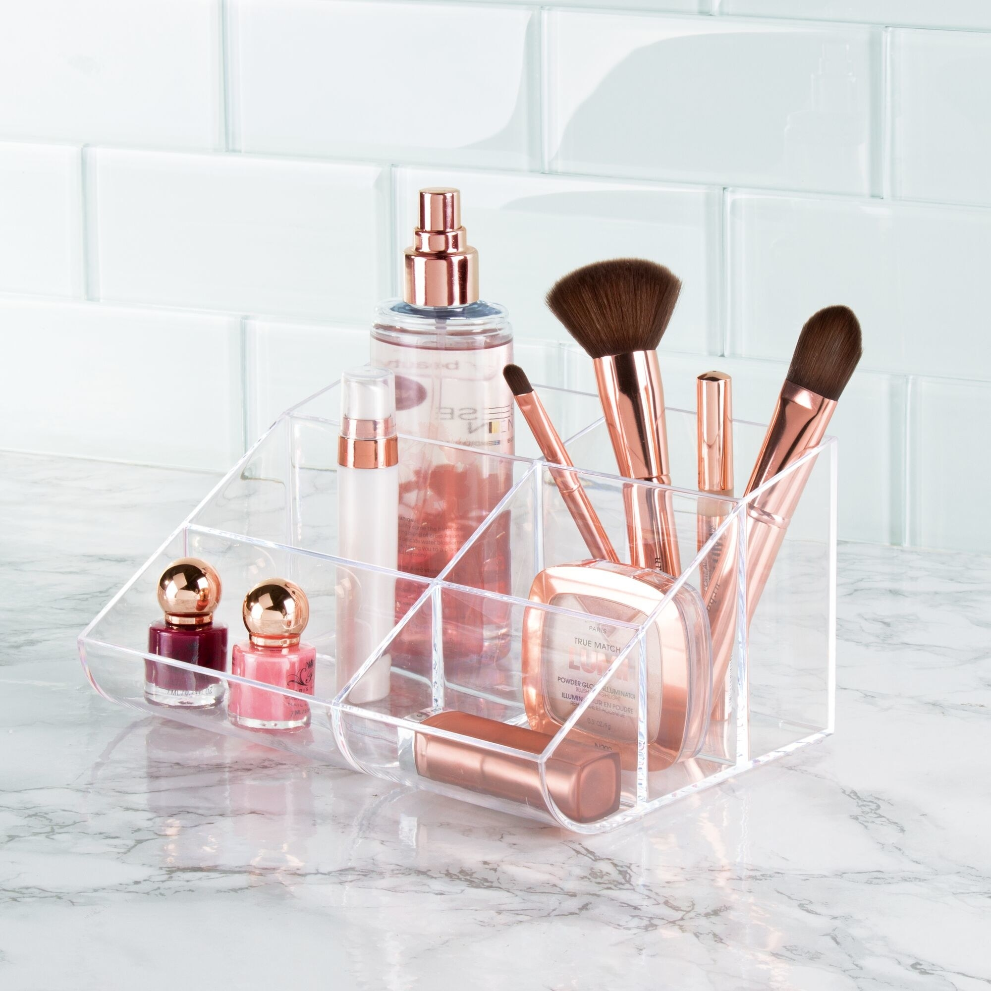 The cosmetics organizer filled with lipsticks, sprays, and makeup brushes