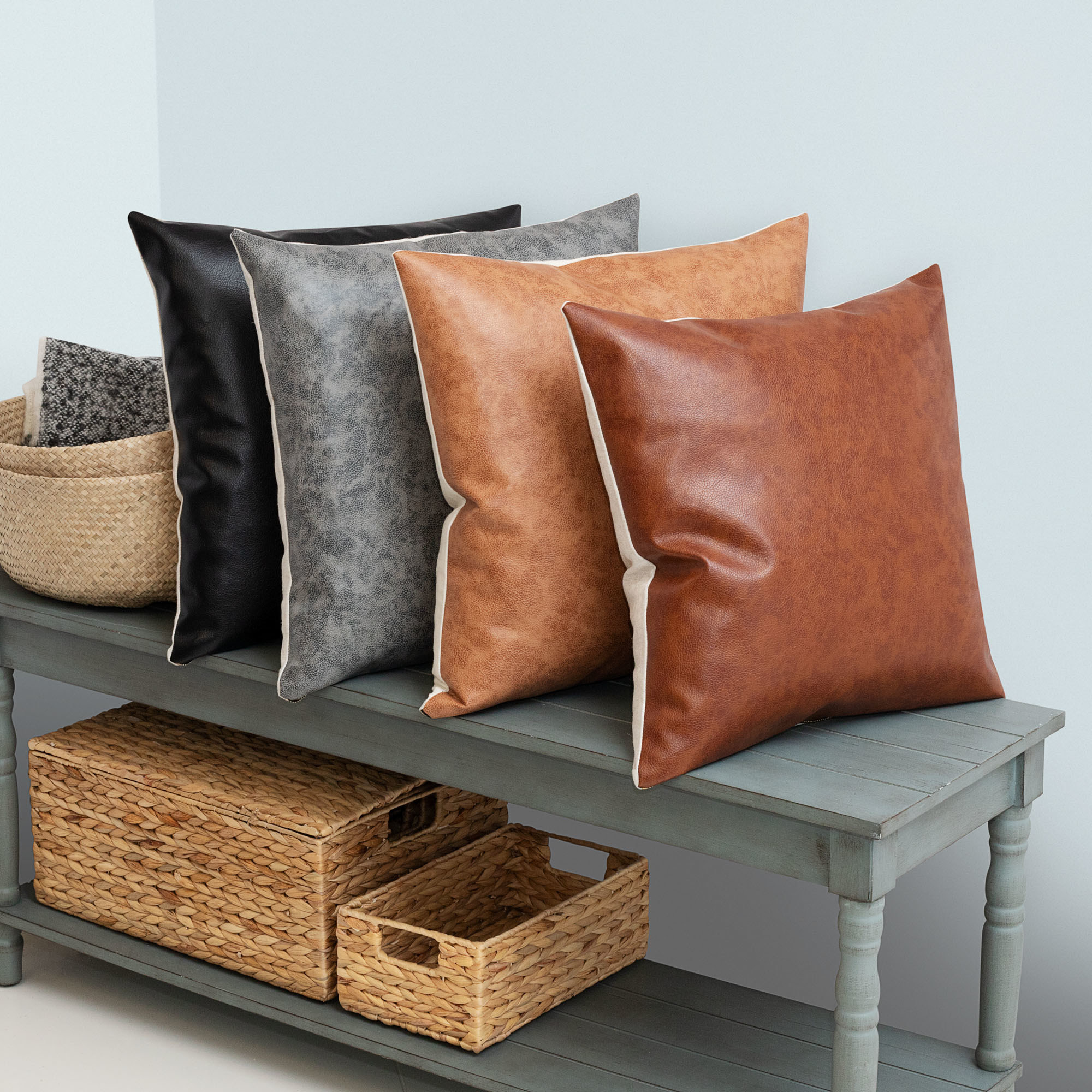 Faux-leather pillows with reversible sides