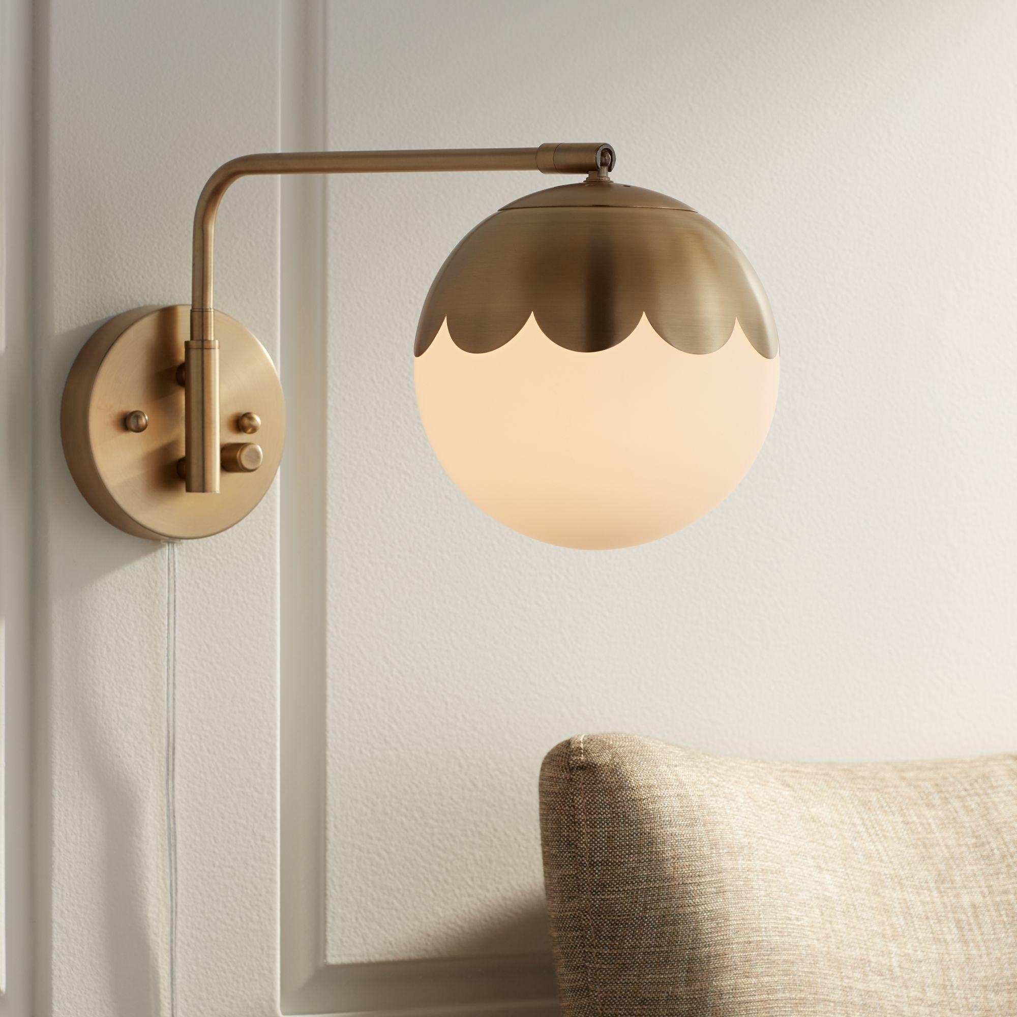 Brass and glass globe light fixture