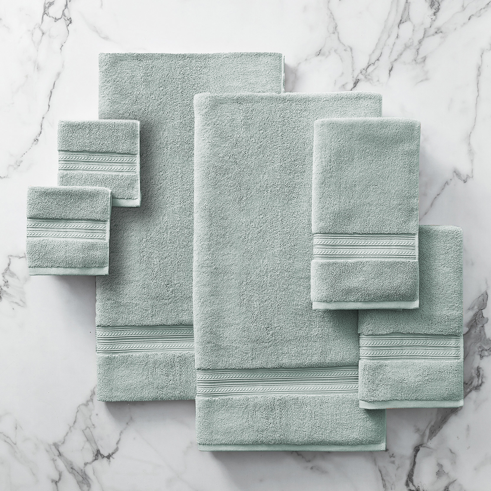 The bath towel set in different sizes in a pale green color