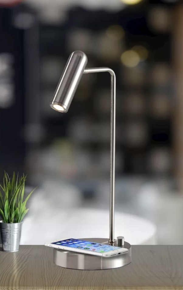 Stainless steel desk lamp with phone charging on the base