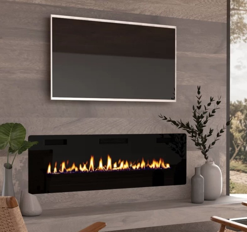 Rectangular electric fireplace on wall under TV