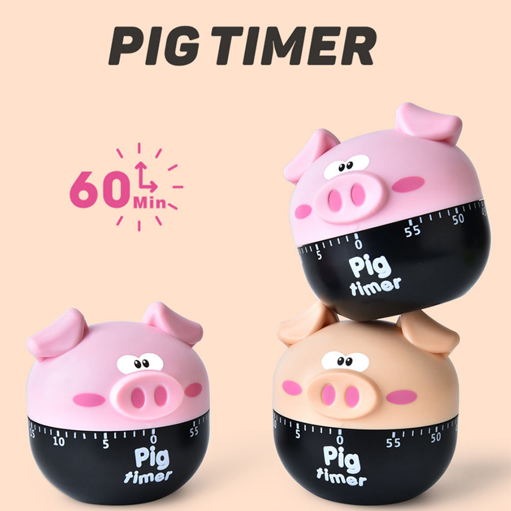 Three of the pig kitchen timers, two in pink and one in orange