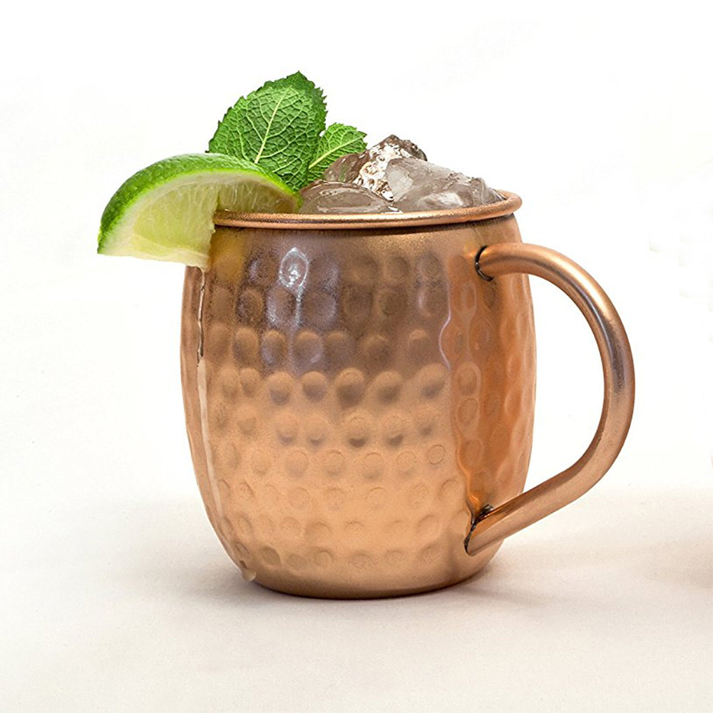 The Moscow mule cup holding a cocktail