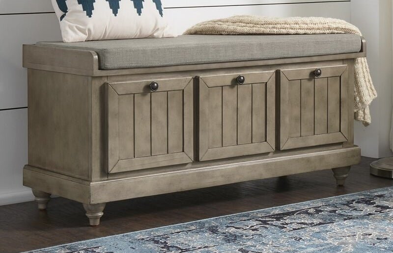 Antique gray storage bench with gray cushion and dark gray knobs