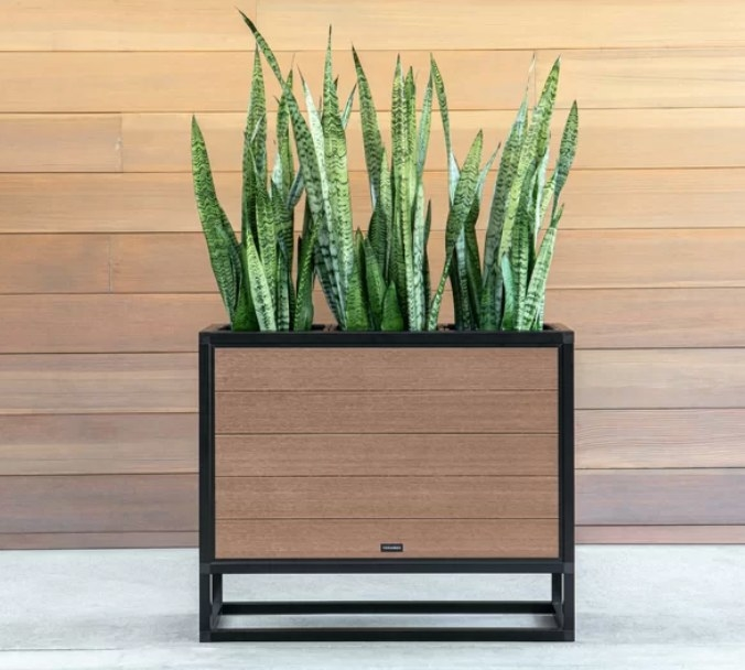 Wooden planter box with black frame
