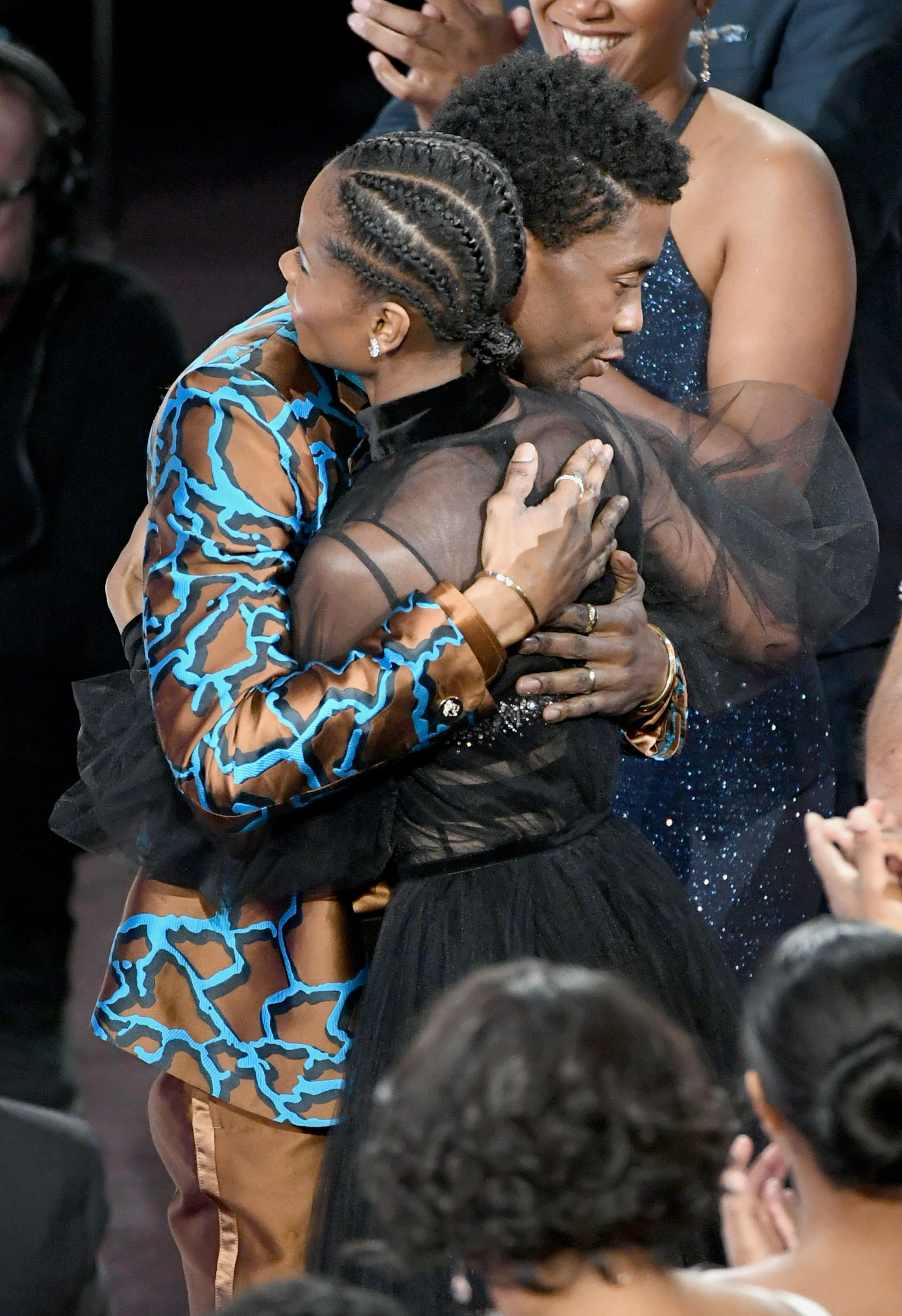 Chadwick Boseman and Letitia Wright hugging each other at the 50th NAACP Image Awards