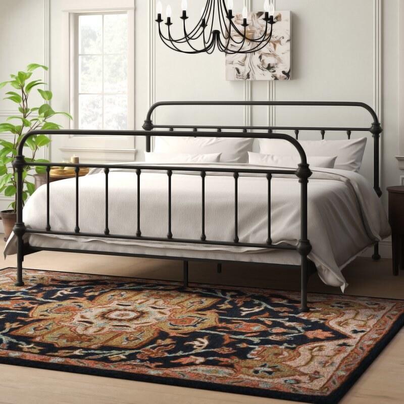 A black metal farmhouse bed frame