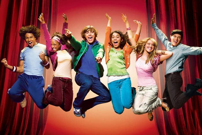 The main cast of High School Musical jumping into the air gleefully