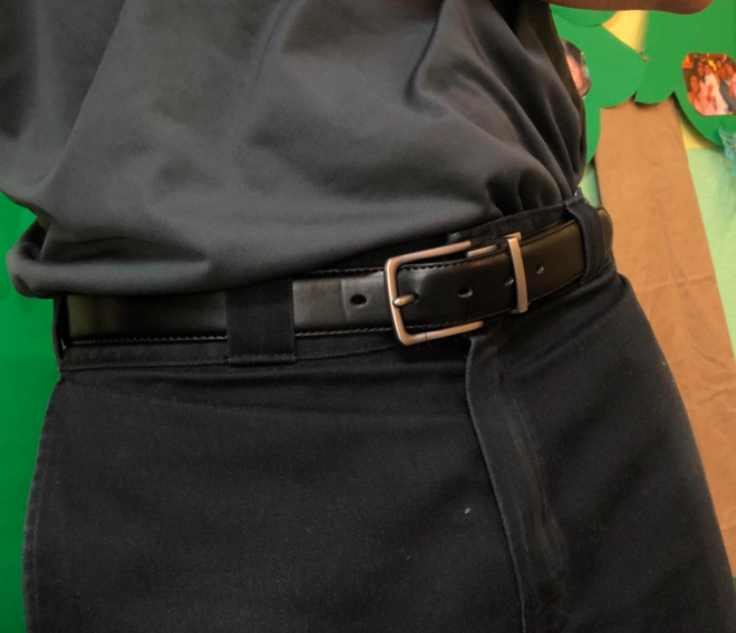 reviewer wearing the belt with the black side facing out