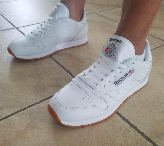 reviewer wearing Reebok classic leather sneakers in white with gum soles