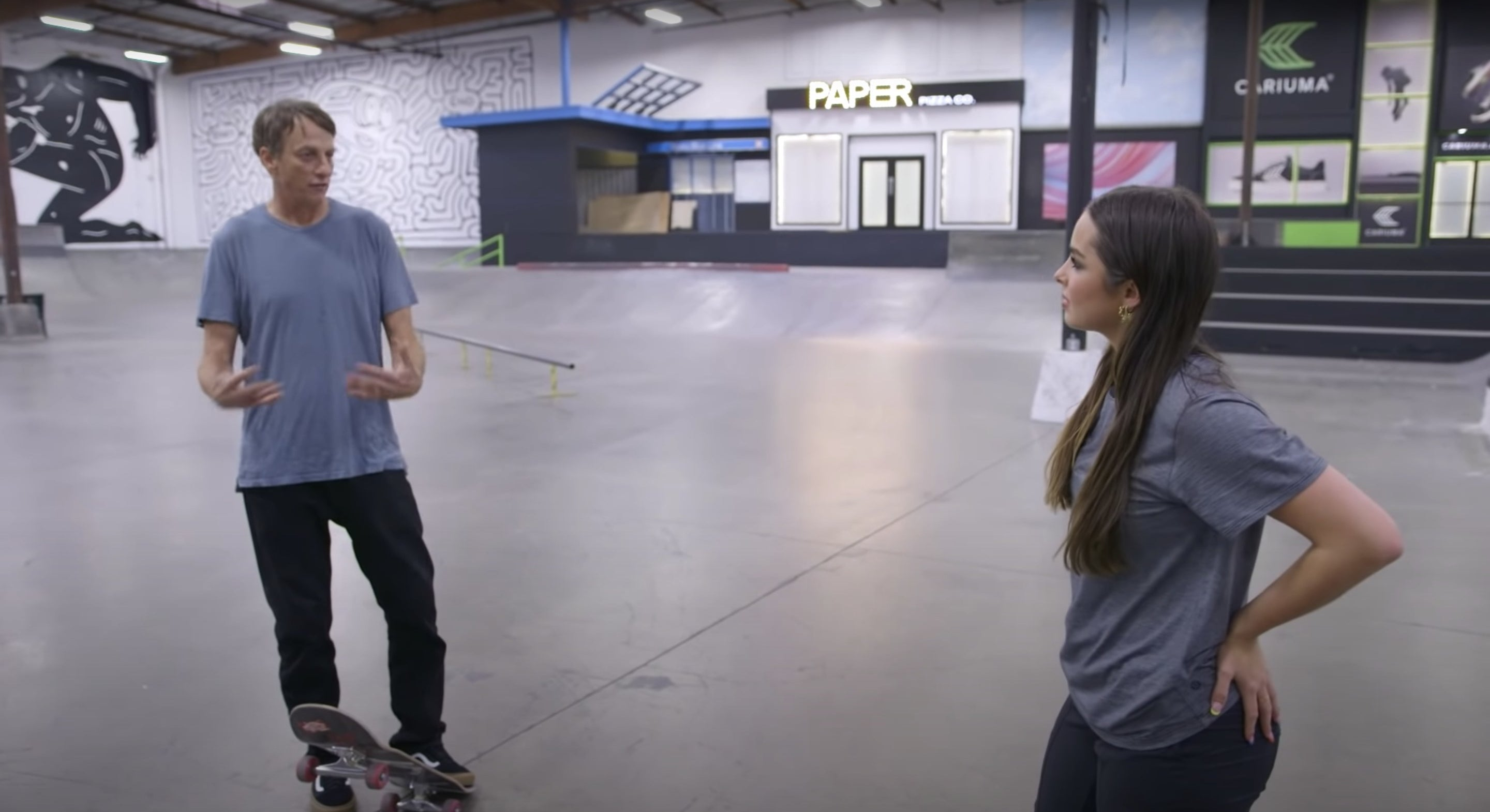Tony talks to Addison at the skatepark