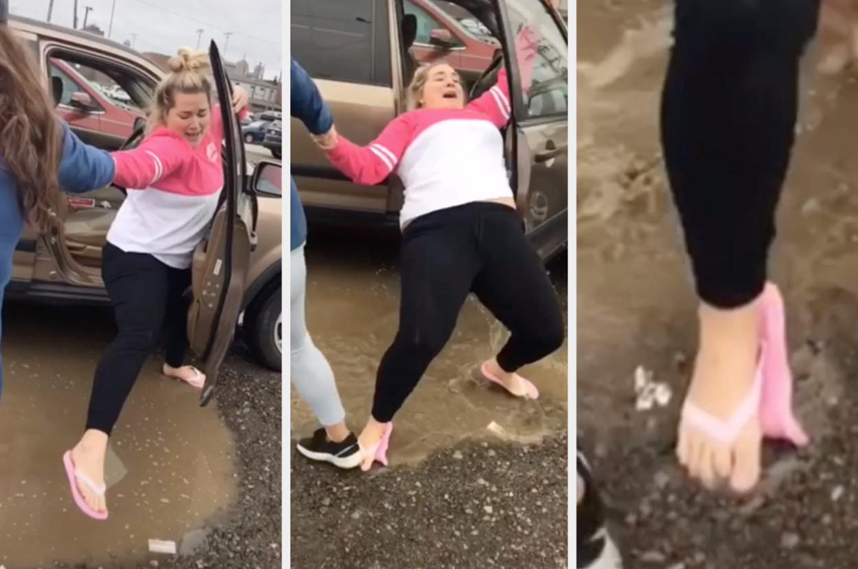 Someone tries to step over a puddle to get outside their car but they end up landing wrong and uncomfortably bending their toe