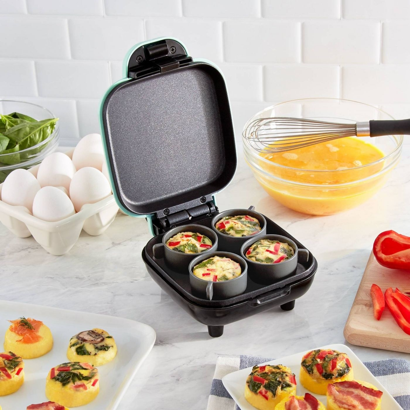 The mini egg maker with space to cook four eggs