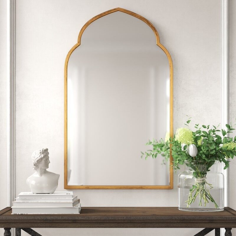 Distressed mirror with gold frame