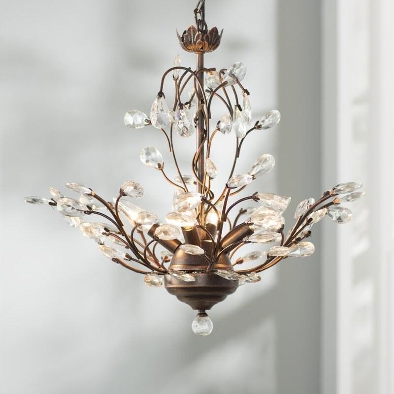 Dark brown chandelier with attached crystals